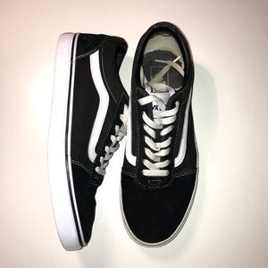 Vans Black and White Mid Top Shoes